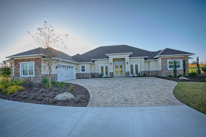 Hollywood-based RCR Homes buit this 5,800-square-foot model home at Saddle Ridge, one of three luxury communities it's developing just outside of The Villages.