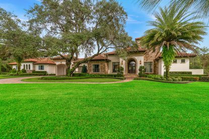 This golf-lover's home in Kissimmee's Happy Trails community sits on 5 acres and comes with concierge service.
