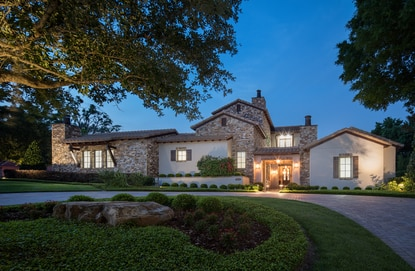 The five-bedroom, five-bath home in Isleworth was designed with a rustic, Tuscan style and smart-home technology system.