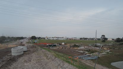 A view from the I-4 flyover bridge currently under constructionthat will link neighboring Oak Ridge Road and Grand National Drive across the interstate to Caravan Court. This view looks southeast, directly on the 16.5 acres owned by North American Properties.