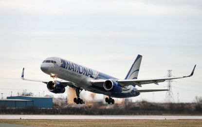 A National Airlines 757-200 takes off from Windsor, Ontario, on its inaugural flight to Orlando Sanford International Airport.