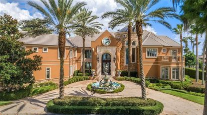 The seven-bedroom home sits within the guard-gated community of Cypress Point.