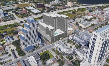 At center is the rendering superimposed on an aerial photo of downtown Orlando's 434 N. Orange Ave. The project includes nearly 900 apartments and 41,000 square feet of retail-commercial with three residential towers of 16 to 24 stories.