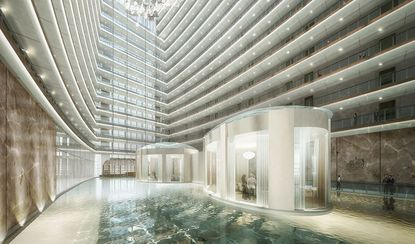 "The newest project rendering above depicts a 220-foot-high (almost 22 stories) atrium planned for Solis, one of two upscale hotels at iSquare Mall + Hotel, with a circulating water future that will float two board rooms and the ""Auriga Spa."""