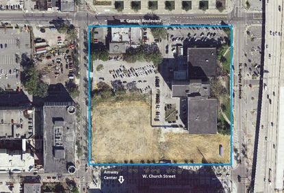 Outlined in blue is the 8.4-acre block planned for redevelopment as the Orlando Magic Entertainment Complex, bounded by W. Central Boulevard, N. Hughey Avenue and W. Church Street. The old Orlando Police Headquarters faces Hughey Avenue.