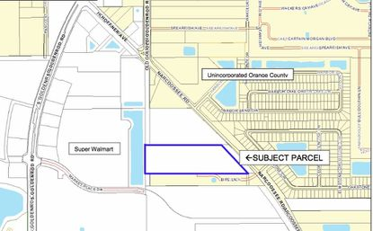 Outlined in blue is a 10-acre parcel between Narcoossee Road on the east and S. Goldenroad Road where a warehouse and retail development is planned.
