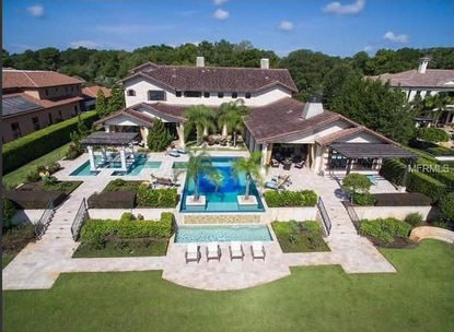 PGA golfer Chris DiMarco recently sold this lakefront mansion in Longwood for $3 million.
