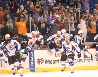 The Orlando Solar Bears celebrate a 4-3 victory against the Florida Everblades in Game 4 of their ECHL first-round playoff series. The series is tied at 2 games each. (Tom Benitez, Orlando Sentinel)