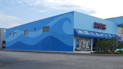 This former surf shop in front of the Vacation Village timeshare resort will be converted into a three-bay retail center with assistance from a W192 Development Authority facade improvement grant.
