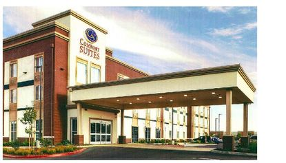 Rendering of a proposed three-story Comfort Suites hotel at 200 W. 1st St., two blocks west of the heart of downtown Sanford.
