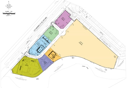This site plan shows the commercial portion of the Osceola Village Center mixed-use PUD. The rehab hospital would go on lot E-1 (green), and the new Daybreak Market would go on lot A (blue).