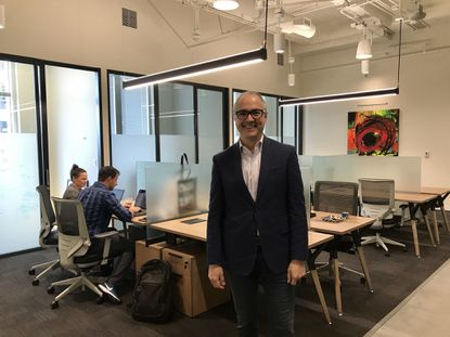 Serendipity Labs CEO John Arenas at the launch of its first co-working lab in downtown Orlando. The company is one of four co-working providers in the market to join the Deskpass online booking platform.