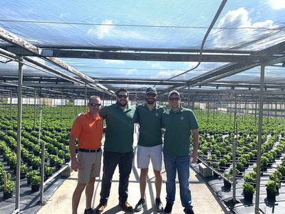 From left, Craig Roth of Sunshine Growers and Green Point Research founders Light Townsend, Jordan Pace and David Hasenauer gather at the Sunshine nursery in Fort Meade.