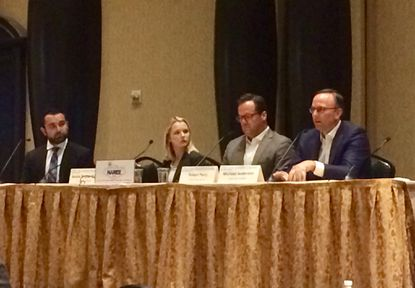 BizNow's Jon Banister, left, moderates a panel of office sector experts to discuss new trends in workspace design, amenities and leasing strategies.
