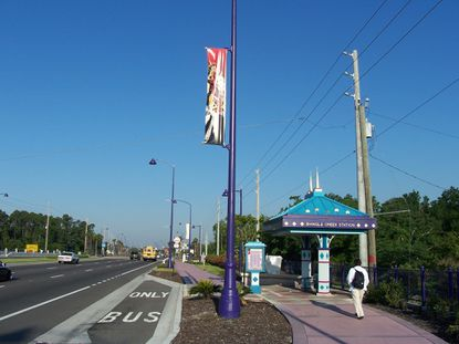 The current design theme on the tourism corridor includes distinctive purple streetlights and bus shelters. Even the sidewalks use purple tinted concrete.