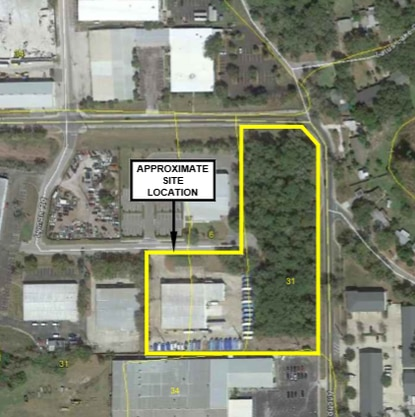 This aerial photo shows the vacant wooded land, outlined in yellow, where an addition will be built to the Nestle Waters North America warehouse at 150 Lyman Road near Casselberry.