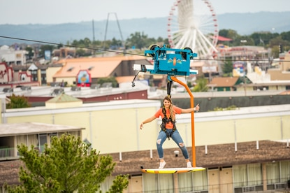 Unlike a traditional zip line, the Skysurfer utilizes a mechanized trolley, so it can go uphill.