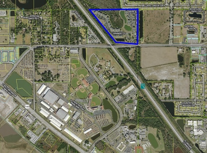 Hercules Real Estate Services paid $26.2 million this week for the 394-unit Grand Court at Boggy Creek apartments, shown in blue, just north of Osceola Heritage Park.