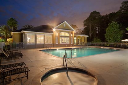 View of the swimming pool and clubhouse at the Knightsbridge at Stoneybrook apartments in east Orlando.