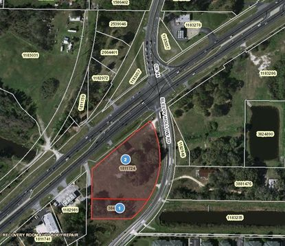 The purchase included two parcels totaling 3.7 acres in Leesburg on Sleepy Hollow Road with frontage on U.S. 441, across from where S.R. 44 comes into the highway.