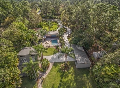 This home and guest home on Orlando's Lake Mary Jane recently sold. This aerial view faces eastward, with the lake on the bottom edge of the photo (out of frame).
