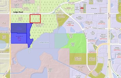 Highlighted in blue are the 42 acres owned by DCT Industrial where its Airport Distribution Center North project is entering Phase 2 development at Conway and Judge roads. The red box shows an approximation of the 11.5 acres DCT bought to provide Judge Road access.