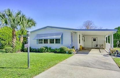 This mobile home in The Villages Orange Blossom Gardens is for sale for $124,000.
