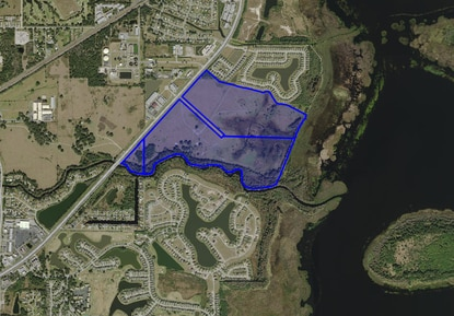 The 194-acre Yates property, shown in blue, could be rezoned to allow for a residential project that would capitalize on the adjacent Shingle Creek Regional Trail.