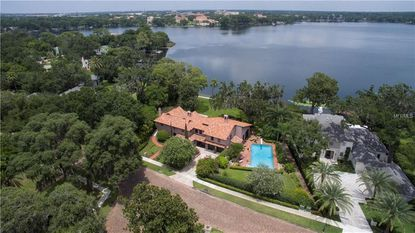 Aerial view of the Winter Park home on Virginia Drive (tan rooftop) that sold last week. The property features views over Lake Virginia toward Rollins College.