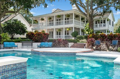 The estate includes a two-story Southern neo-classical style house with 550 feet of shoreline and a heated pool and outdoor spa.