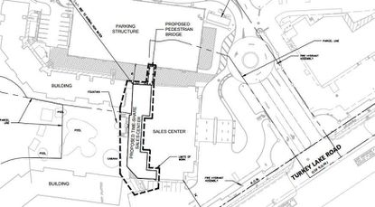 The dotted black line highlights the rear of the sales center building that will be expanded, as well as the proposed pedestrian bridge to the new parking garage next door.