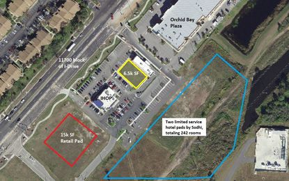 A view of Phoenicia Development's multitenant retail building under construction (yellow) and remaining retail pad (red) in the 11700 block of International Drive that is available, and the 5.2 acres now owned by hotel developer B.P. Sodhi (blue).