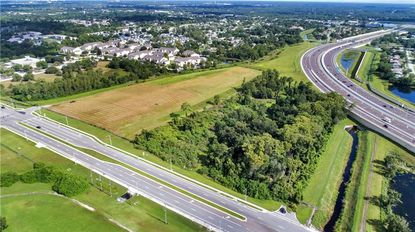 An aerial of the land under contract at 8751 Valencia College Lane.