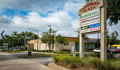 Marketing image of an entry point to the Publix-anchored Conway Plaza shopping center on Curry Ford Road.