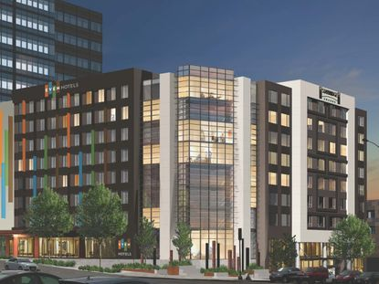 A rendering for a dual-branded EVEN Hotels and Staybridge Suites hotel in downtown Seattle.