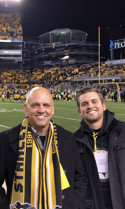 Custom homebuilder Rial Jones and son, R.J., take in a Pittsburgh Steelers game.