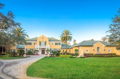 View of the front of a home recently sold on Isleworth Country Club Drive to Joseph A. Sivigilia, chairman of Vineland Motor Sales.