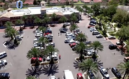 An aerial view of the parking lot serving Trader Joe's and Slate at Unicorp National Development's Parkside retail center, on W. Sand Lake Road in Dr. Phillips.