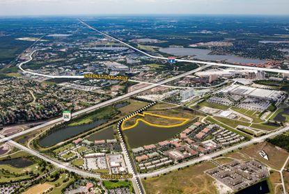 Outlined in yellow is the 14-acre former Wells Fargo Bank-owned parcel that was acquired on Friday. The white dashed line indicates the path of the future Destination Parkway connection between Tradeshow and Universal boulevards.