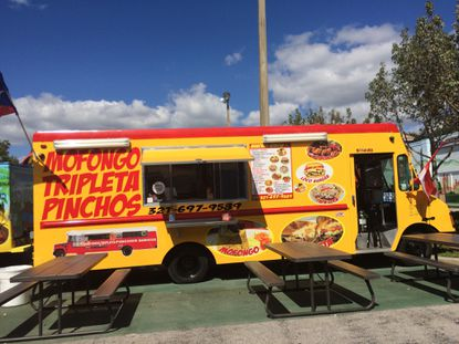 One of 40 food trucks that make up a new outdoor food court at the Visitors Flea Market on W192 at International Drive.