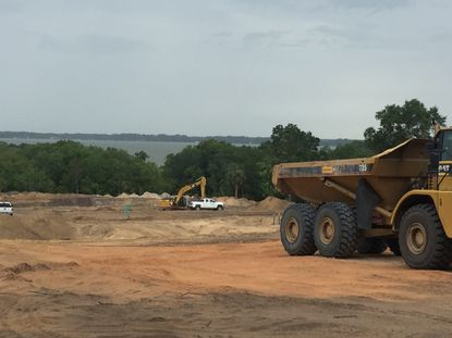 Contractors are moving dirt for a new home sudivision overlooking Lake Dora in Mount Dora.