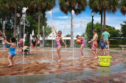 Kids cool off at the splash pad in popular downtown Winter Garden recently. St. Cloud wants to emulate Winter Garden's success.