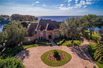 This six-bedroom traditional brick estate home has expansive views of the 22,000-acre Lake Tohopekaliga.
