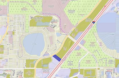 Highlighted in blue is the 2.75-acre parcel along Palm Parkway, just south of the intersection with Daryl Carter Parkway and west of Interstate 4.