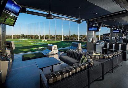 Marketing image of a Topgolf interactive driving range.
