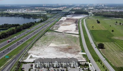 This aerial image captured on June 5 shows the 38.8 acres along Palm Parkway and Interstate 4, looking south toward the Daryl Carter Parkway overpass. The property was almost fully mass graded at the time.