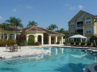 A view of the pool and community building at the Grand Reserve at Kirkman Parke condominium complex, in MetroWest.