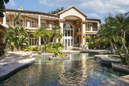 The six-bedroom house on Point Cypress overlooks a resort like pool with fountains and waterfalls. It has a private boathouse on Lake Sheen that can accommodate a boat and two jet skis.