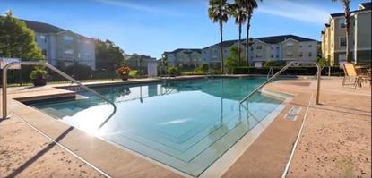 A pool-area view of the Magnolia Pointe apartments in Orlando, acquired by Starwood Property Trust.