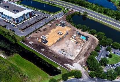 Aerial photo from mid-June of the S. International Drive construction site of a new La Quinta Inn & Suites, with a Phase 2 pad next to it planned for a Tryp by Wyndham hotel.